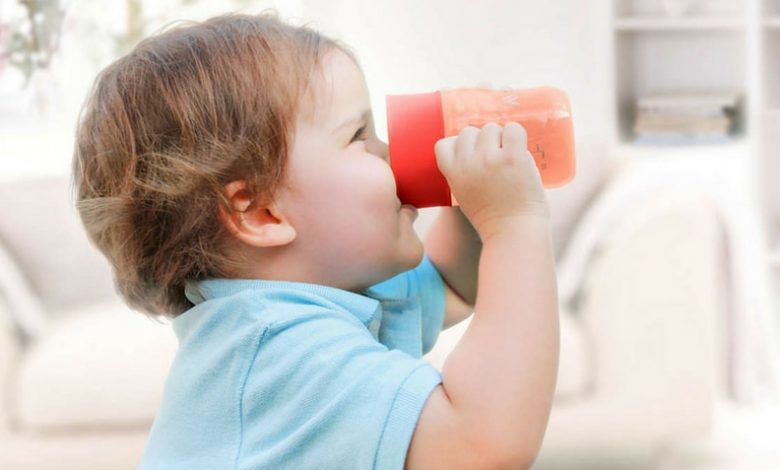 When can toddlers drink from a cup?
